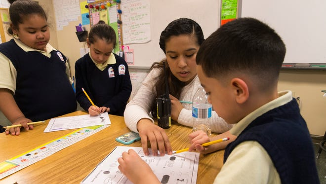 Community Learning Center tutor Wendy Lunda helps first-grader Javier Ibarra (right) with math at the after-school community learning center at the La Causa Charter School, 1643 S. 2nd St. in Milwaukee.