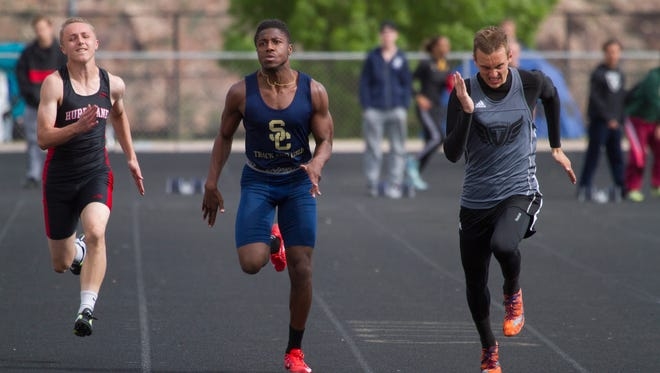 Tae Washington (center) runs in a Region 9 track meet in this file photo. Washington broke the 4A state record on Saturday at the BYU Invitational.