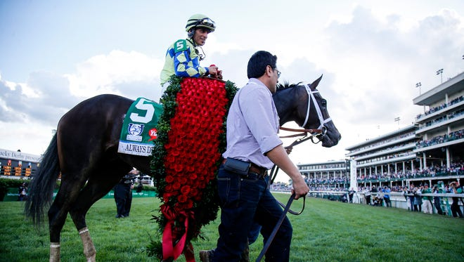 John Velazquez celebrates after riding Always Dreaming to victory in the 143rd running of the Kentucky Derby horse race at Churchill Downs Saturday, May 6, 2017, in Louisville, Ky.