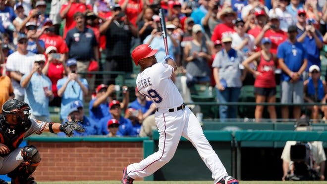 Rangers' Adrian Beltre follows through on a double for his 3,000th career hit.
