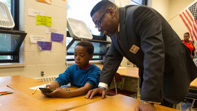 Milwaukee Public Schools Interim Superintendent Keith Posley visits with a student during his first day on the job in May. Posley has unveiled an ambitious plan to reorganize schools in the 53206 ZIP code.