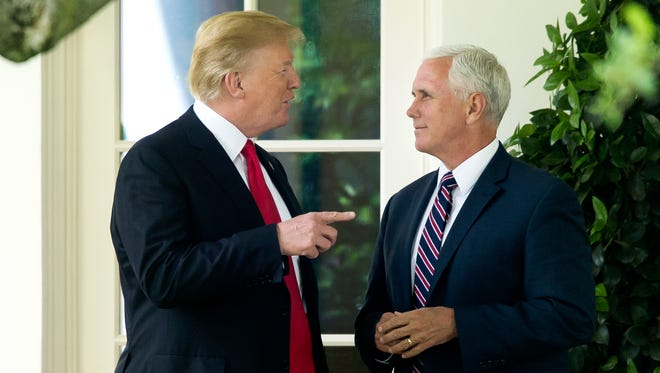 US President Donald J. Trump (L) and US Vice President Mike Pence (R) speak with one another outside the West Wing before Trump departs the South Lawn by Marine One, at the White House in Washington, DC, USA, 29 May 2018.