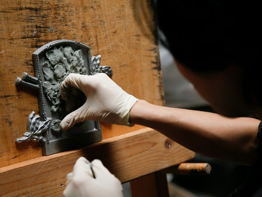 Tsuchiya works in his studio, which is located in Walnut