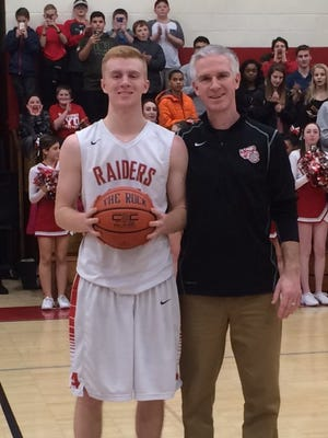 Dennis Hare poses with Red Hook High School boys basketball coach Matt Hayes after reaching 1,000 career points on Wednesday.