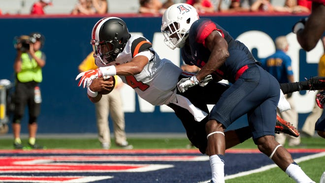 Oct 10, 2015; Tucson, AZ, USA; Oregon State Beavers quarterback Seth Collins (4) scores a touchdown as he is tackled by Arizona Wildcats safety Will Parks (11) during the second quarter at Arizona Stadium. Mandatory Credit: Casey Sapio-USA TODAY Sports