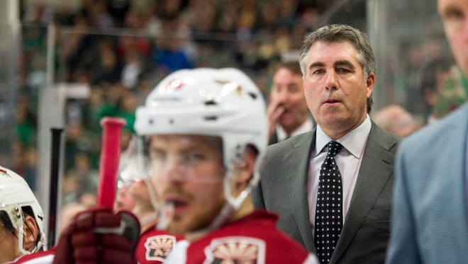 Nov 20, 2014: Coyotes head coach Dave Tippett watches his team take on the Dallas Stars during the third period at the American Airlines Center. The Stars defeated the the Coyotes 3-1.