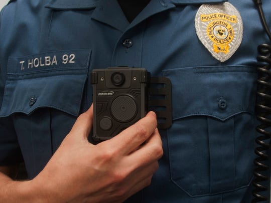 Officer Taylor Holba shows the position of his body camera at the Burlington Township Police Department Wednesday. Body cameras will be tested by four police officers in class and in police cars.