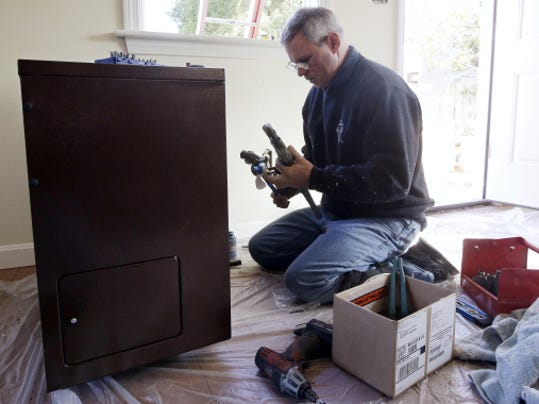 Plumber David Murphy of Mayer's Heating Service sets up a gas valve as he installs a direct vent furnace in a house in East Wareham, Massachusetts. Natural gas overtook coal as the top source of U.S. electric power generation for the first time ever in April.