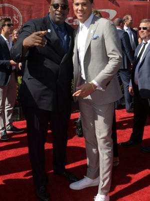 Phoenix Suns guard Devin Booker, right, arrives at the 2016 ESPYs.