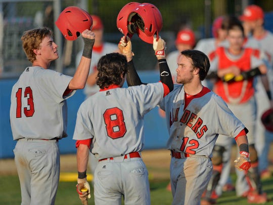Greenville's Grant Cox (12) celebrates a RBI home run with teammates Lucas Coan (13) and Drew Davenport. Wren varsity baseball hosted Greenville in Class AAA Upper State tournament Monday, May 12, 2014.