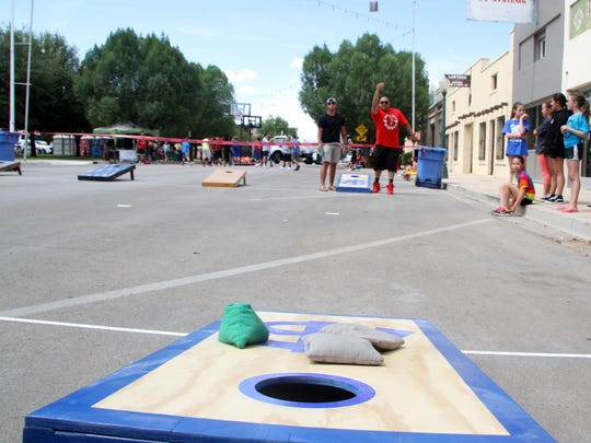 A man throws bags during a cornhole tournament at Saturday's CavernFest.