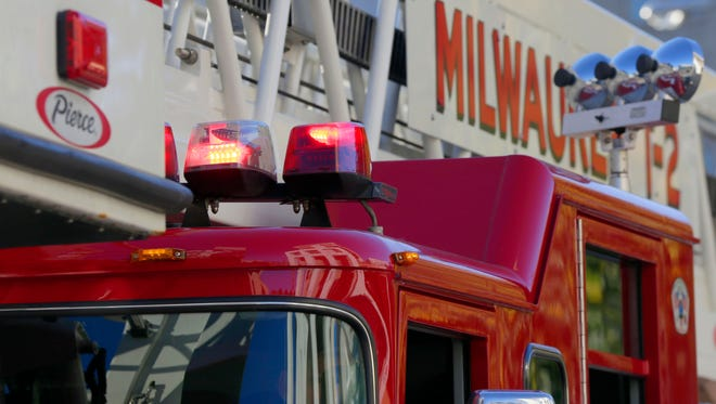 Gov. Scott Walker's administration abruptly backed off Wednesday on plans to roll back a requirement for fire sprinklers, but the state might not adopt other safety standards that firefighters say would save lives.