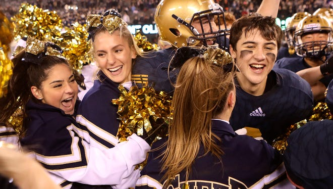 Old Tappan cheerleaders and football players celebrate their 31-28  victory over Mt. Olive for the NJSIAA North I Group IV Football Championship in East Rutherford. (Kevin R. Wexler/@krwphoto)