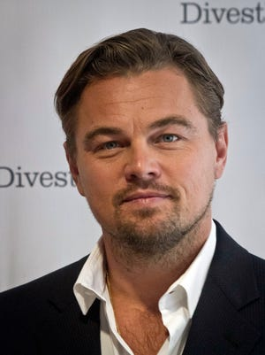 Actor Leonardo DiCaprio poses for a photograph after attending a news conference for the Divest-Invest Coalition, Tuesday, Sept. 22, 2015, in New York.  DiCaprio plans to divest his own and his foundation's fossil fuel holdings, said Ellen Dorsey, a leader of the campaign. (AP Photo/Bebeto Matthews)