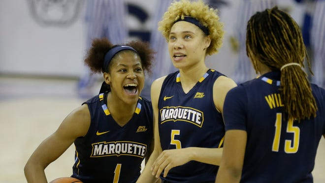 Marquette's Danielle King (1) Natisha Hiedeman (5) and Amani Wilborn celebrate during the second half of a Big East tournament semifinal Monday, March 6, 2017, at the Al McGuire Center.