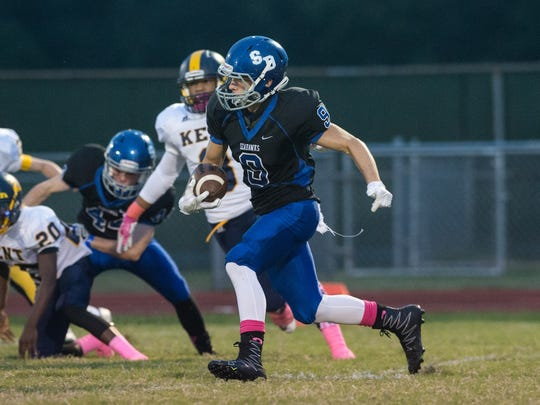 Stephen Decatur's John Curtis (9) runs the ball during a game against Kent County.