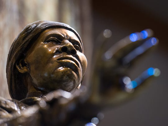 A sculpture portraying Harriet Tubman stands in the