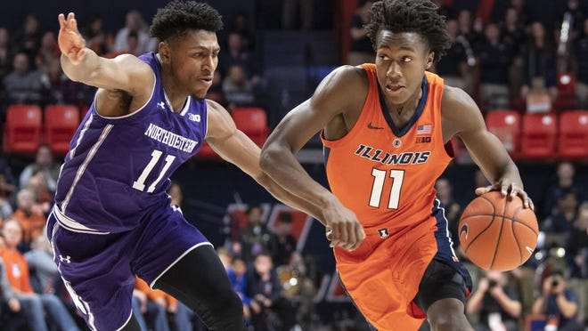 This March 3, 2019, file photo shows Illinois guard Ayo Dosunmu (11) driving to the basket against Northwestern guard Anthony Gaines (11) during the first half of an NCAA college basketball game in Champaign.