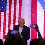 Durante su primera comparecencia pública en San Juan, donde hoy pasará todo el día haciendo campaña, Sanders instó a la Reserva Federal a que utilice su autoridad para facilitar una reestructuración ordenada de la deuda de 70.000 millones de dólares.