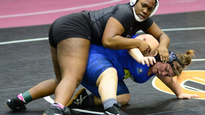 Washburn Rural's Dajia Anderson, top,  looks back at her coaches while holding Nickerson's Maddi Miller in the semi-final round in the 235 weight-division the Kansas State High School Activities Association, KSHSAA, Girl`s Wrestling Inaugural State Championship at the Tony's Pizza Events Center in Salina on Thursday, February 27, 2020. Anderson won by fall in 2:34.