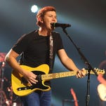 Country music singer-songwriter Scotty McCreery performs in concert in 2014.