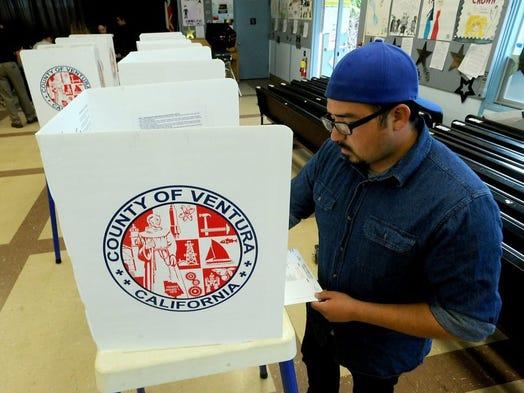 ROB VARELA/THE STAR Matthew Becerra votes at Tierra Vista Elementary School in Oxnard Tuesday.