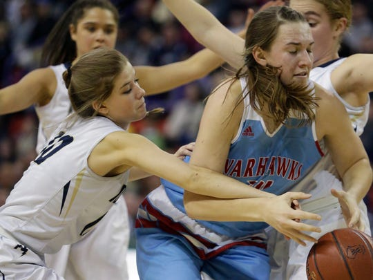 Appleton North's Anna Laux (left) knocks the ball away from Arrowhead's Caitlyn Harper during the second half Friday night.