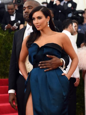 Kanye West (L) and Kim Kardashian arrive at the Costume Institute Benefit at The Metropolitan Museum of Art May 5, 2014 in New York. AFP PHOTO/Timothy A. CLARYTIMOTHY A. CLARY/AFP/Getty Images ORG XMIT: 488658201 ORIG FILE ID: 529514009