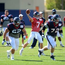 Aug 20, 2014; Englewood, CO, USA; Houston Texans quarterback Case Keenum (7) passes before the start of a scrimmage against the Denver Broncos at the Broncos training facility. Mandatory Credit: Ron Chenoy-USA TODAY Sports