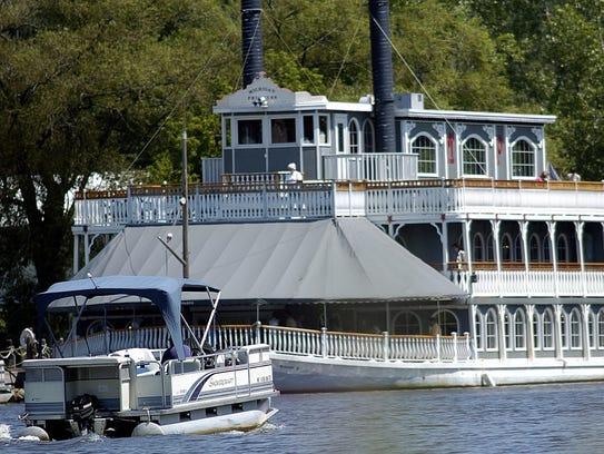 A pontoon boat cruises by the Michigan Princess.