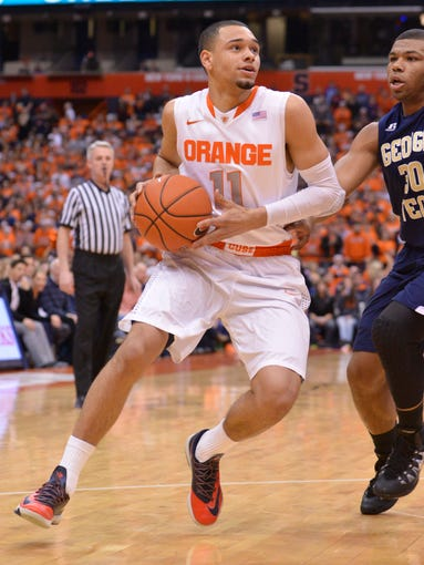 Syracuse Orange guard Tyler Ennis (11) drives the ball during the first half of a game against the Georgia Tech Yellow Jackets at the Carrier Dome.