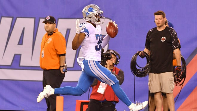 The Lions' Jamal Agnew runs back a punt 88 yards for a touchdown in the fourth quarter.