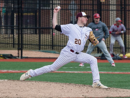 Salisbury University's Connor Reeves (20) throws a pitch during a game against Cortland on Saturday, Feb. 17, 2018.