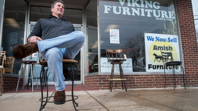 Stuart Weiss, who co-owns Viking Furniture with his mother Rose Weiss, sits in front of his Maple Shade store. 01.27.15