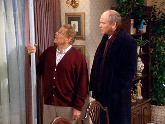 """Jerry Stiller (left, with Daniel von Bargen) explains the meaning of the Festivus pole, the holiday invented on the hit sitcom """"Seinfeld."""" A company in Milwaukee makes Festivus poles."""