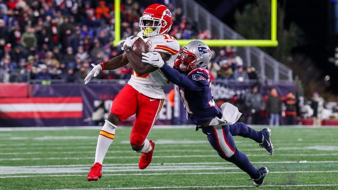 Kansas City Chiefs receiver Tyreek Hill (10) is tackled by New England Patriots cornerback Jonathan Jones (31) during the first half at Gillette Stadium on Dec. 8, 2019.