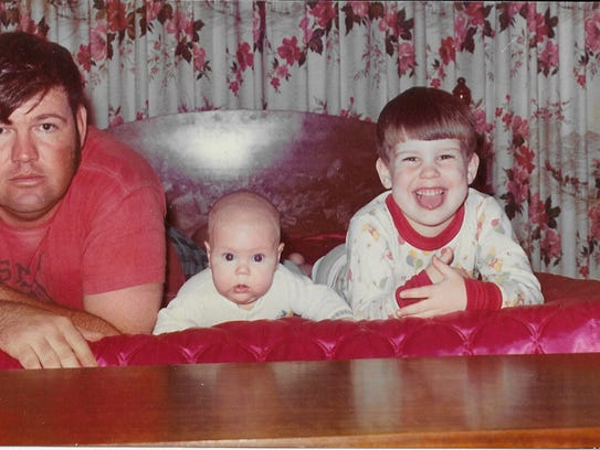 Bart Millard as a baby in 1973 with his father, then