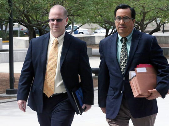 James Anderson, left, former assistant superintendent for secondary education at the El Paso Independent School District, walks into federal court with his lawyer, Robert Perez, in 2017.