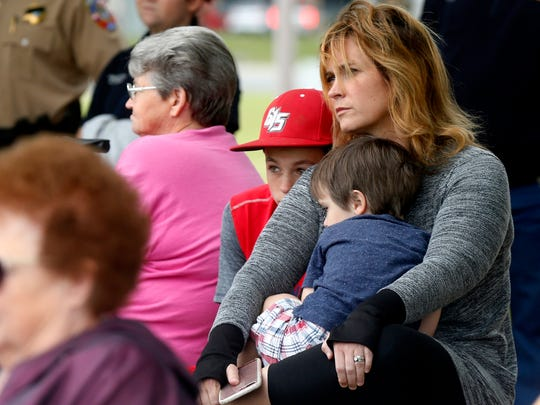 Amy Jones is surrounded by her sons Brooks Jones, 12, and Beckham Jones, 3, as they listen to Chief Jon Maggard of Police Services at the Tennessee Valley Healthcare System present the keynote speach during the Sept. 11th ceremony at the Rutherford County SheriffÕs office, on Monday, Sept. 11, 2017.