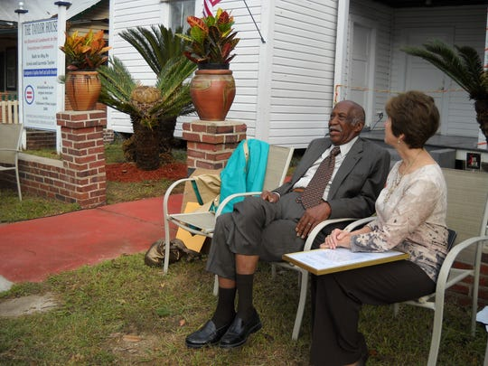 James Ford, left, talks with Tallahassee City Commissioner Nancy Miller at the grand opening of the Taylor House Museum in Frenchtown on Oct. 29, 2011. In 1971, James Ford became the first black man elected to the Tallahassee City Commission and went on to serve 14 years.