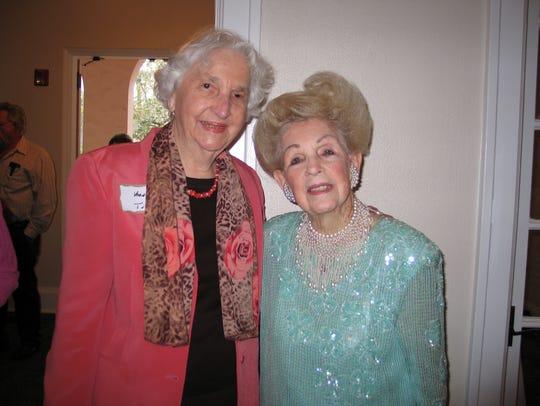 Vernelle Tucker, left, celebrates friend Lillian Cox's