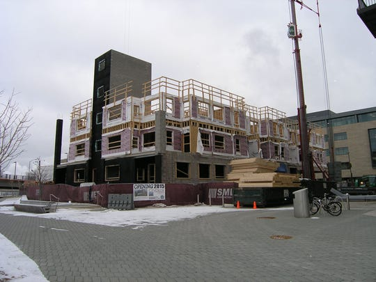 Three of CityDeck Landing's floors take shape in downtown Green Bay. The $10 million, 84-unit apartment building at North Washington and Main streets is scheduled for completion in early summer 2015.