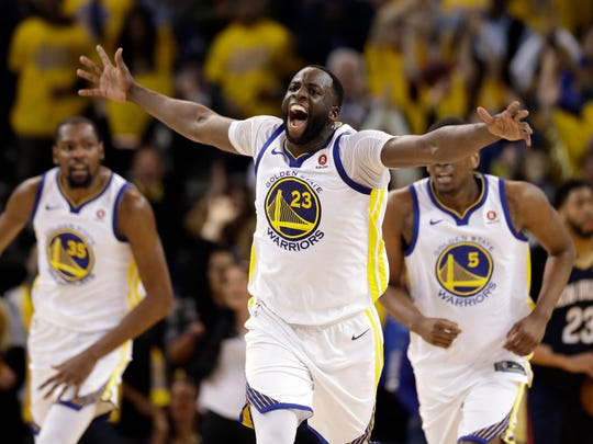 Golden State Warriors' Draymond Green celebrates after a basket against the New Orleans Pelicans during the first half in Game 1 of an NBA basketball second-round playoff series Saturday, April 28, 2018, in Oakland, Calif.