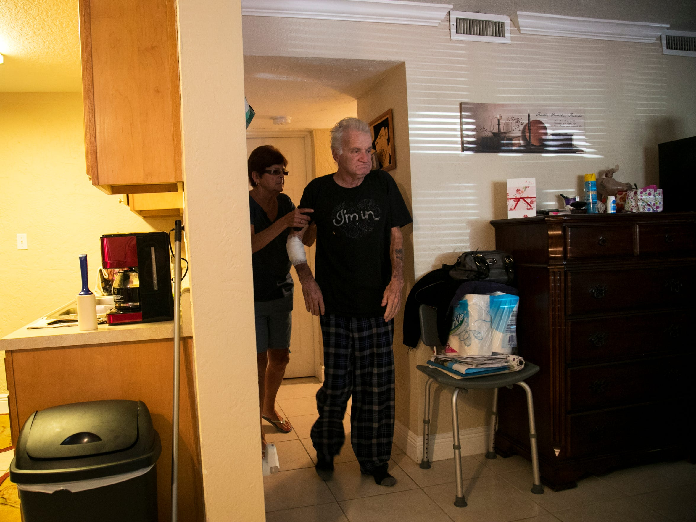 John Tagtmeir gets help from his wife Kathleen getting