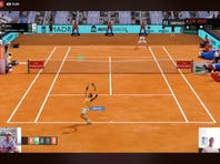 "A screen grab taken on Monday April 27, 2020 showing Spain's Rafael Nadal, bottom left, playing against Canada's Denis Shapovalov, bottom right, in a ""virtual"" tennis match at a tournament hosted by the Madrid Open. Tennis has joined the video game craze taking over the sports world during the coronavirus pandemic, with Rafael Nadal, Andy Murray and 30 other pros trading in their rackets for controllers this week to participate in a ""virtual"" tournament hosted by the Madrid Open. (Mutua Madrid Open via AP)"