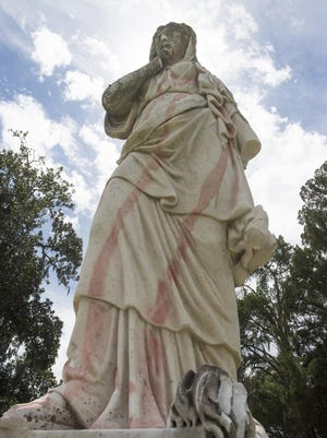 "After being vandalized twice in less than a month, the Confederate memorial statue in Laurel Grove Cemetery is missing two arms and bearing faded red paint. The statue, called ""Silence"" originally held her right index finger over her mouth, and her left hand held a torch facing the ground."