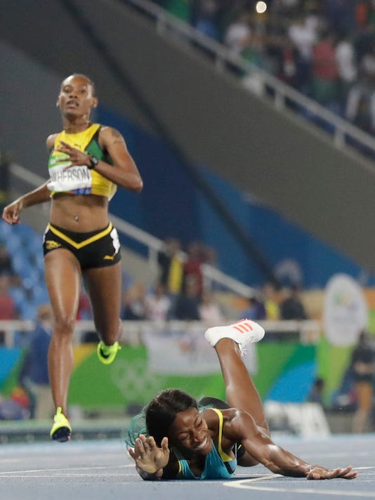 Head-first dive earns gold for runner from Bahamas