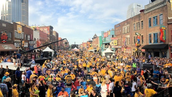 The crowd lines Lower Broadway for the Stanley Cup Final Game 3 celebration on Saturday.