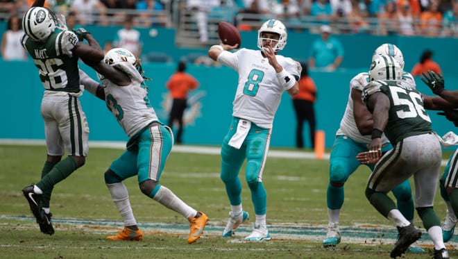 Miami Dolphins quarterback Matt Moore (8) looks to pass during the second half against the New York Jets on Sunday.