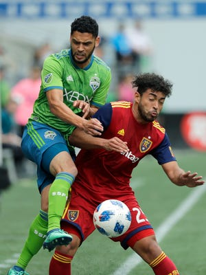 Seattle Sounders midfielder Lamar Neagle, left, battles for the ball with Real Salt Lake midfielder Danilo Acosta, right, during the second half of an MLS soccer match Saturday, May 26, 2018, in Seattle. Real Salt Lake won 1-0. (AP Photo/Ted S. Warren)